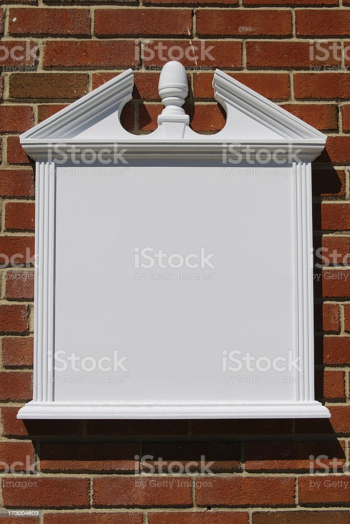Blank Colonial Sign On Brick Wall royalty-free stock photo