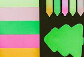 Blank colorful sticky notes set on black background