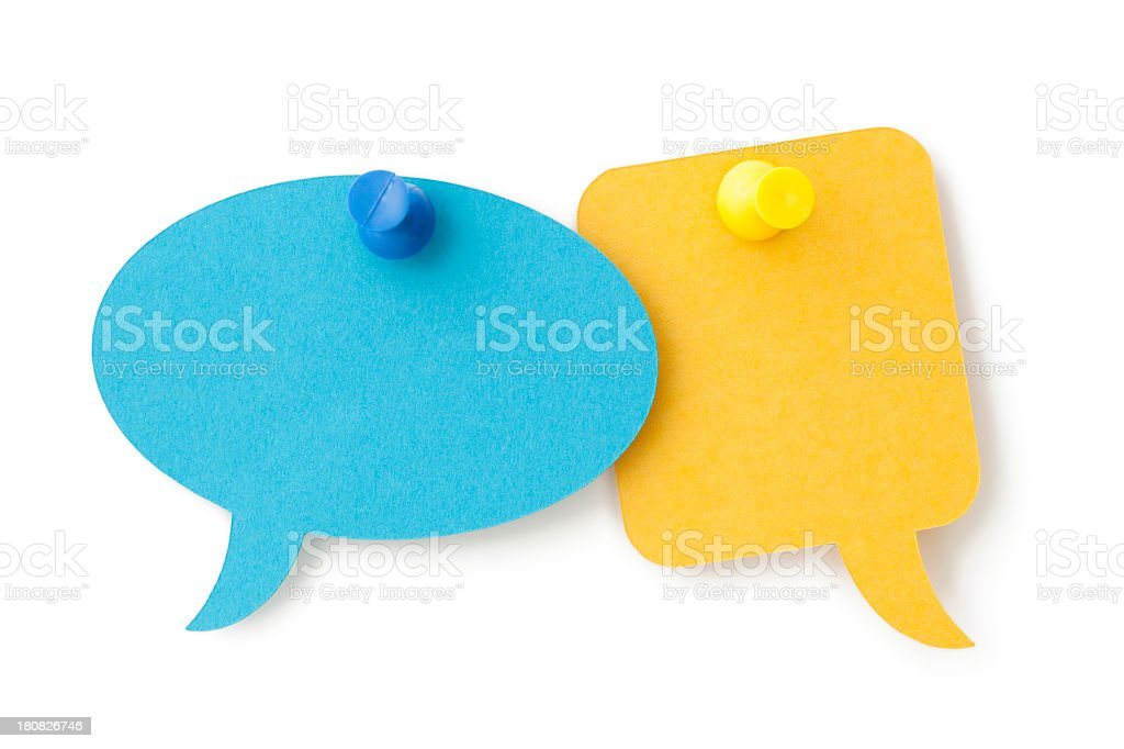 TWO blank colourful speech bubbles pinned to a white surface stock photo