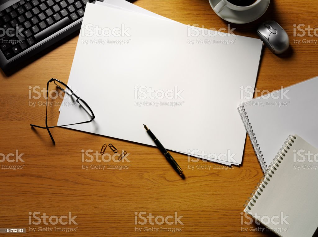 Blank Computer Paper on the Office Desk with Stationery stock photo
