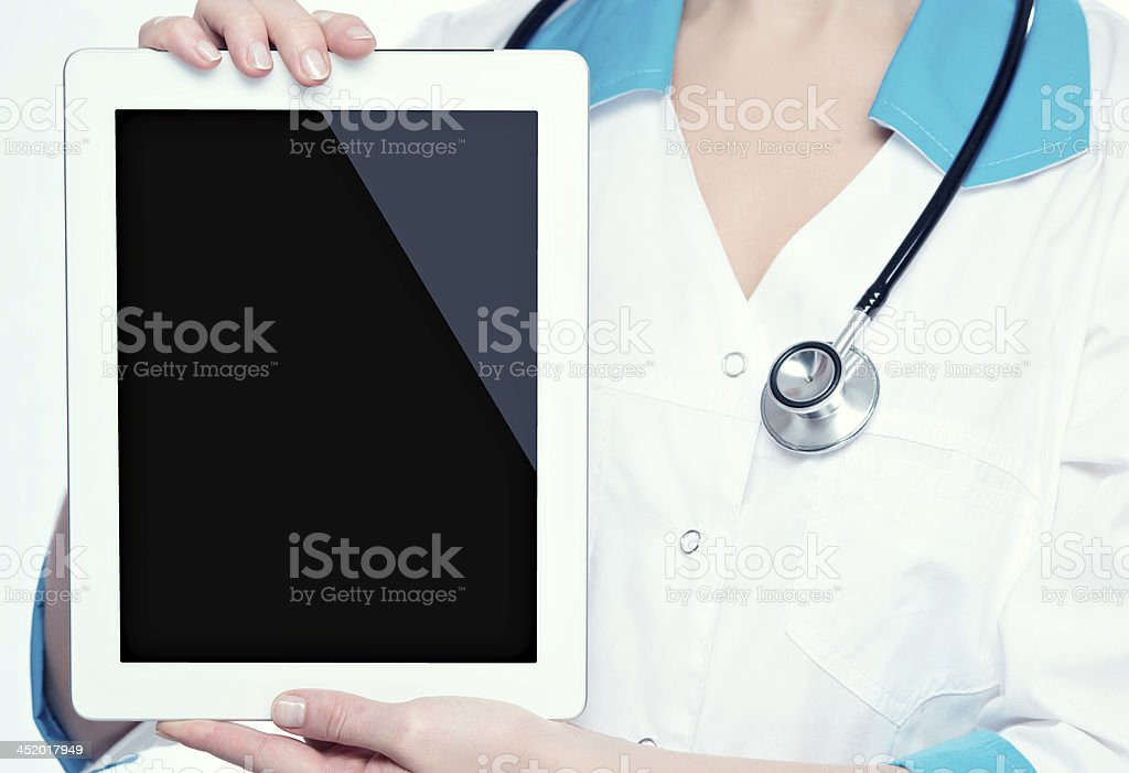 blank computer tablet in the hands of doctor royalty-free stock photo