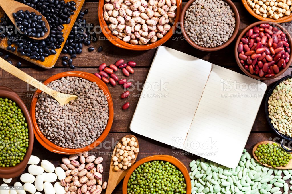 Blank cookbook and legumes stock photo