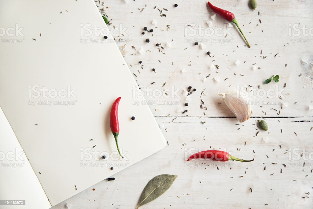 Blank cookbook with herbs and spices stock photo