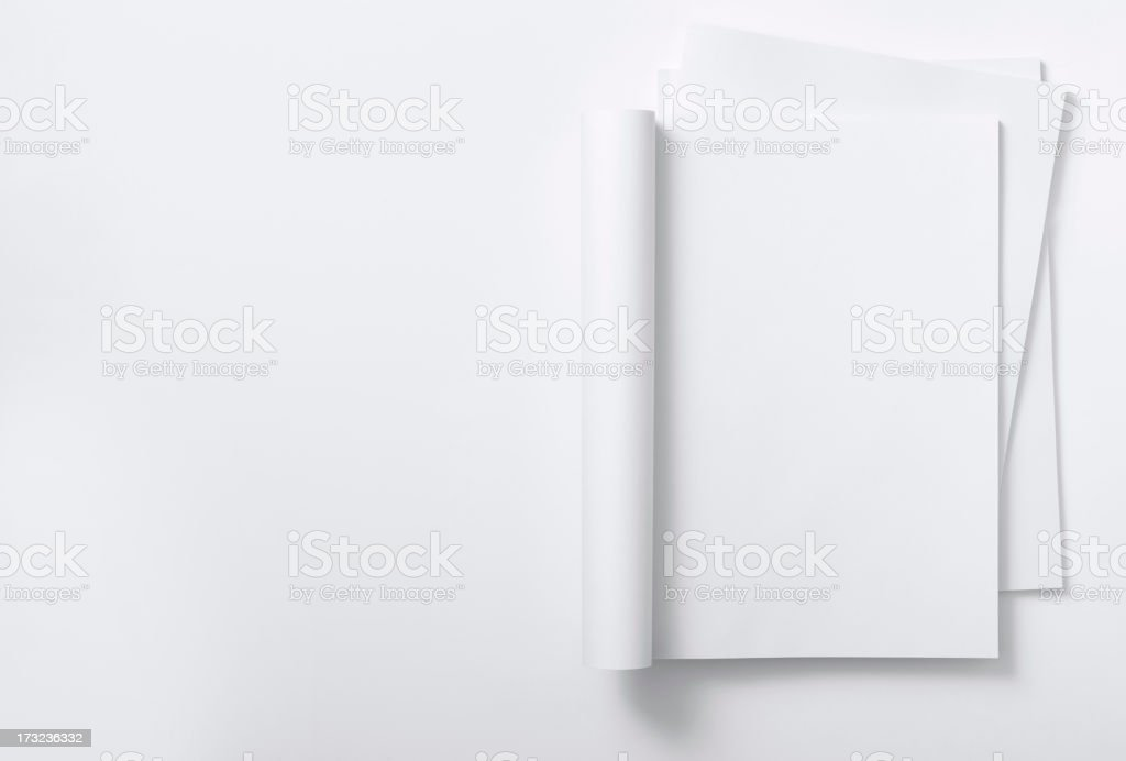 Blank curved magazine on a magazine stack stock photo