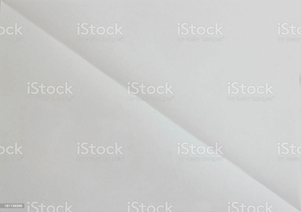Blank diagonaly folded sheet of paper. background royalty-free stock photo