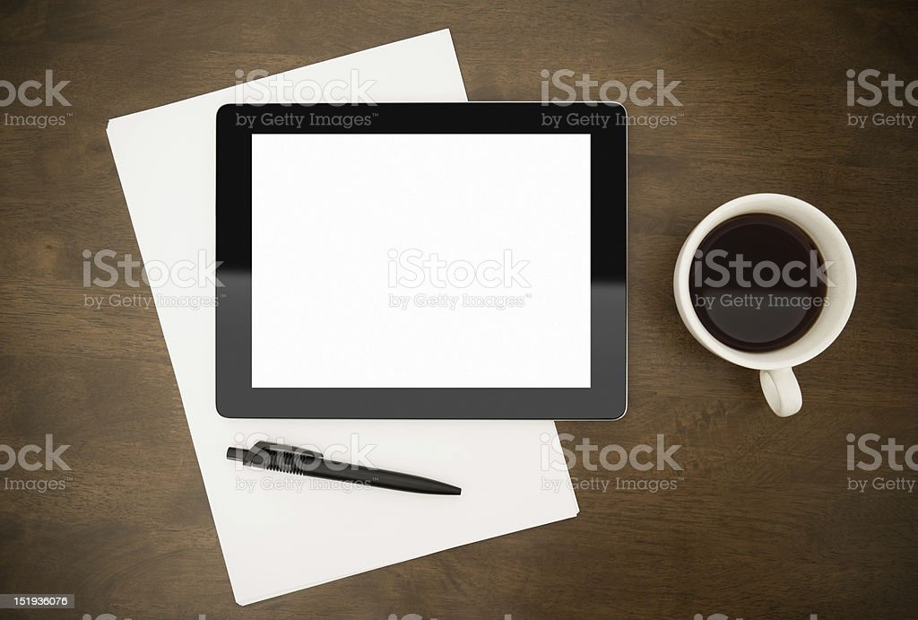 Blank Digital Tablet and a cup of black coffee on desk stock photo