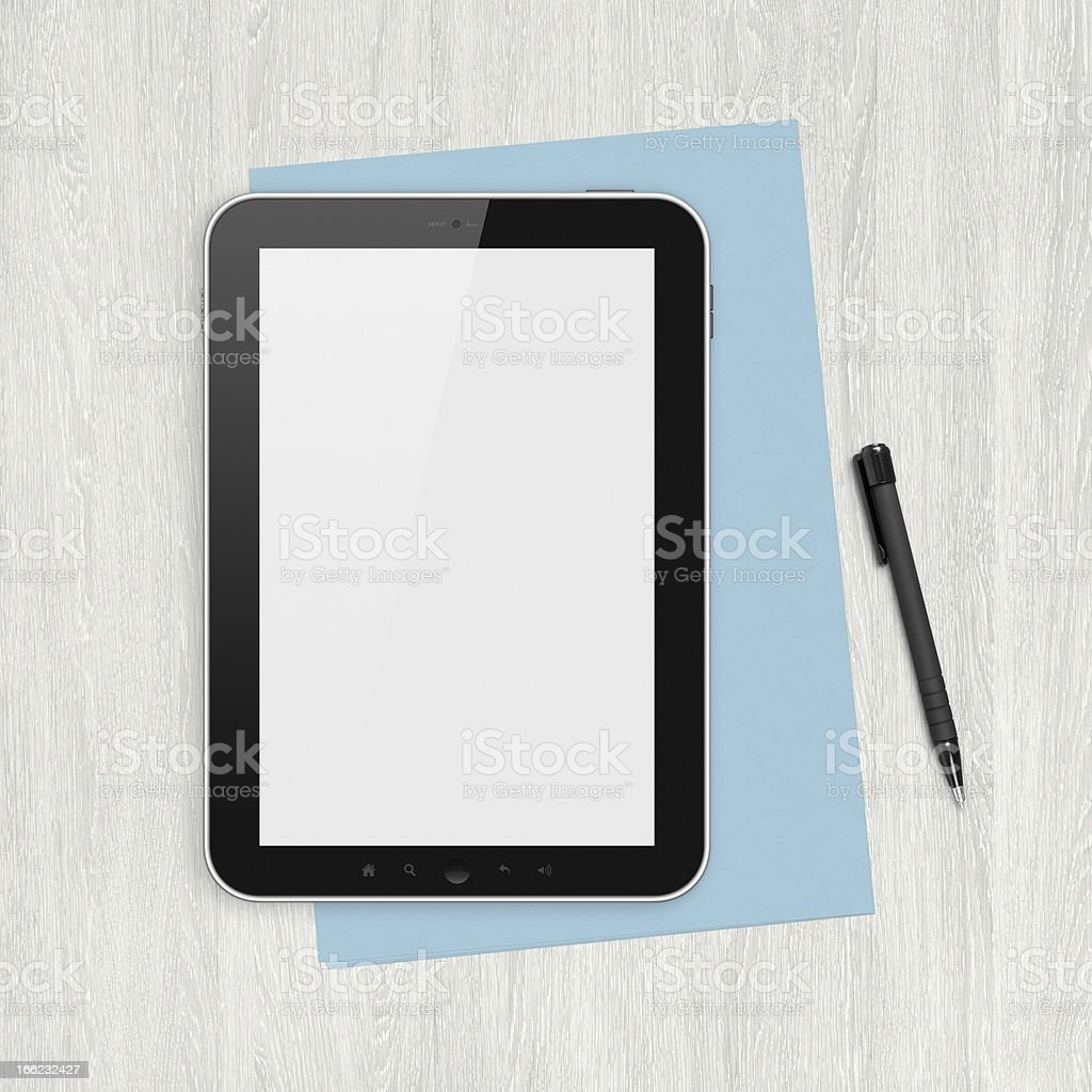 Blank digital tablet on a white desk royalty-free stock photo