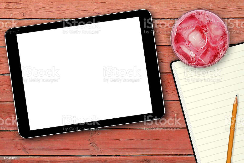 blank digital tablet on wooden table royalty-free stock photo