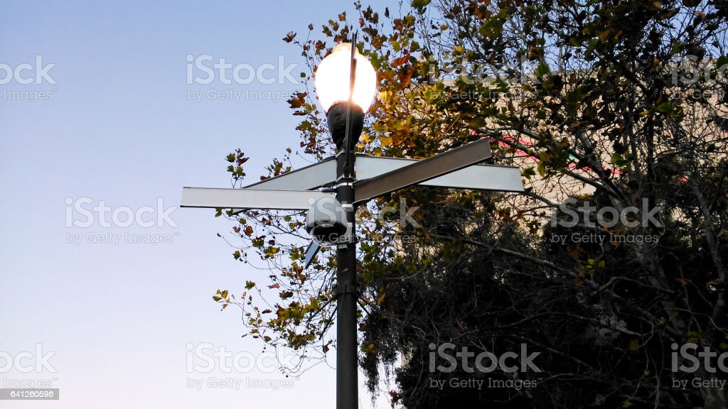 Blank directional signs and street light stock photo