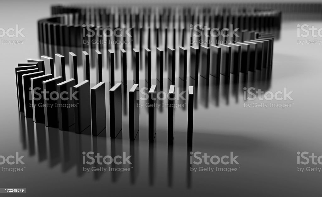 Blank domino pieces set up to fall over in a chain reaction stock photo