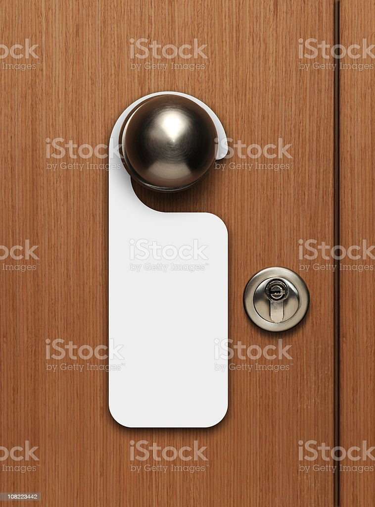 Blank door sign hanging from knob stock photo