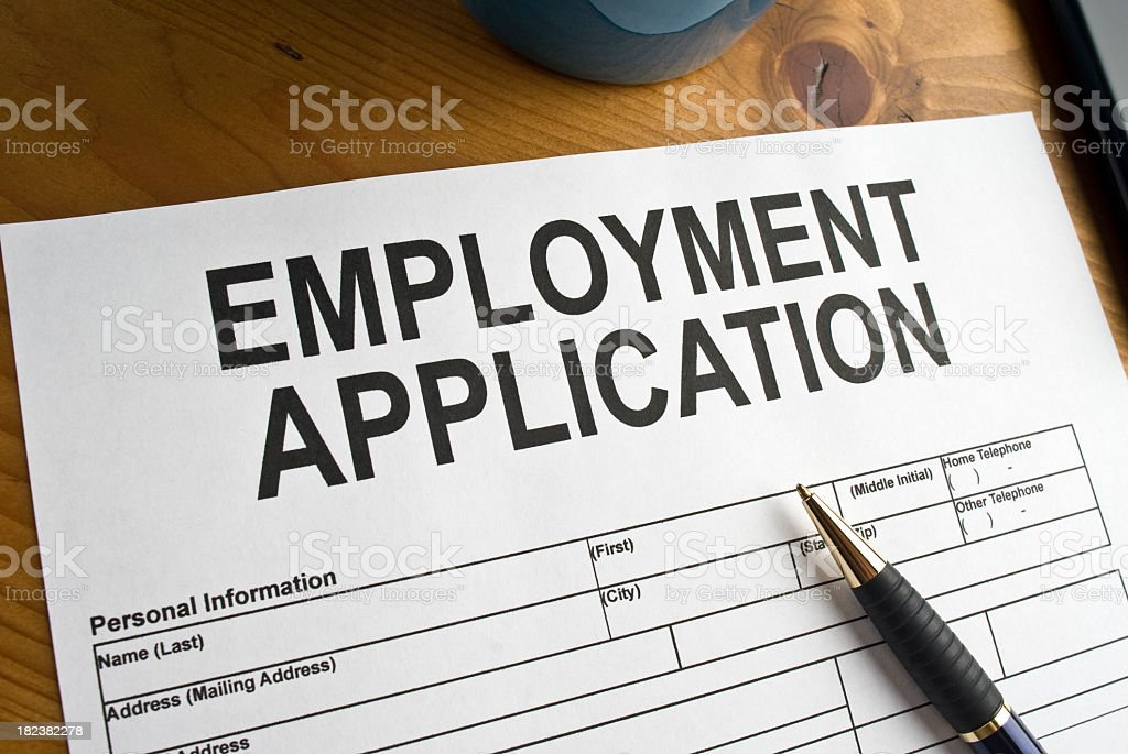 Blank employment application ready to be filled out stock photo