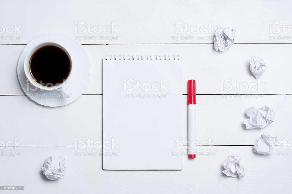 Blank empty notepad with coffee on table stock photo