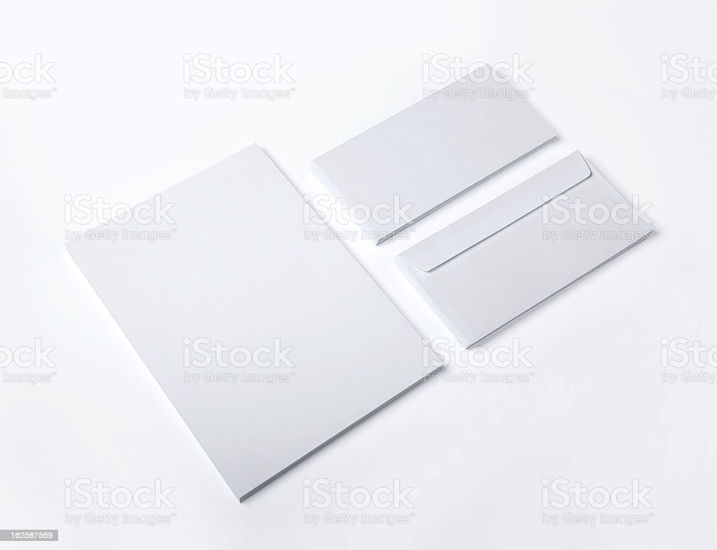 Blank Envelopes and A4 stack isolated stock photo