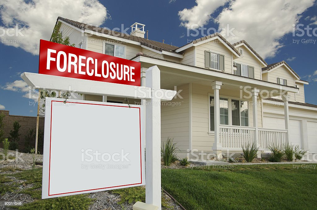 Blank Foreclosure Sign in Front of House stock photo
