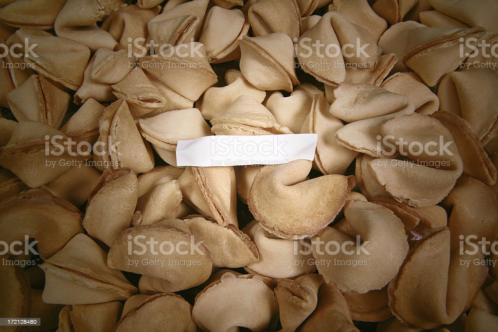 Blank fortune in a sea of fortune cookies stock photo
