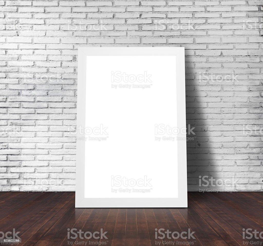 Blank frame on white brick wall stock photo