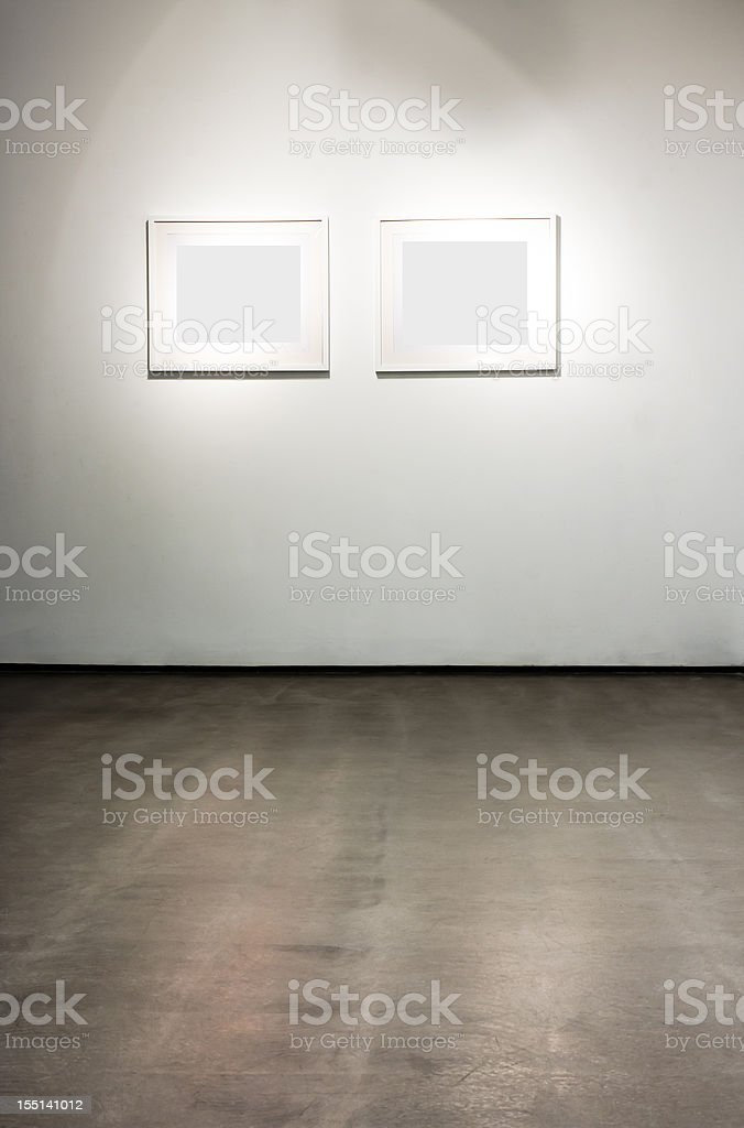 Blank frames on the wall at art gallery stock photo