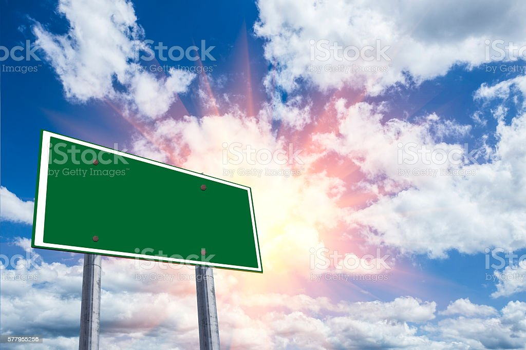 Blank freeway sign against a blue sky. stock photo