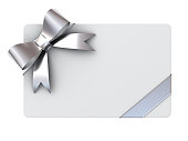 Blank gift card with silver ribbons and bow