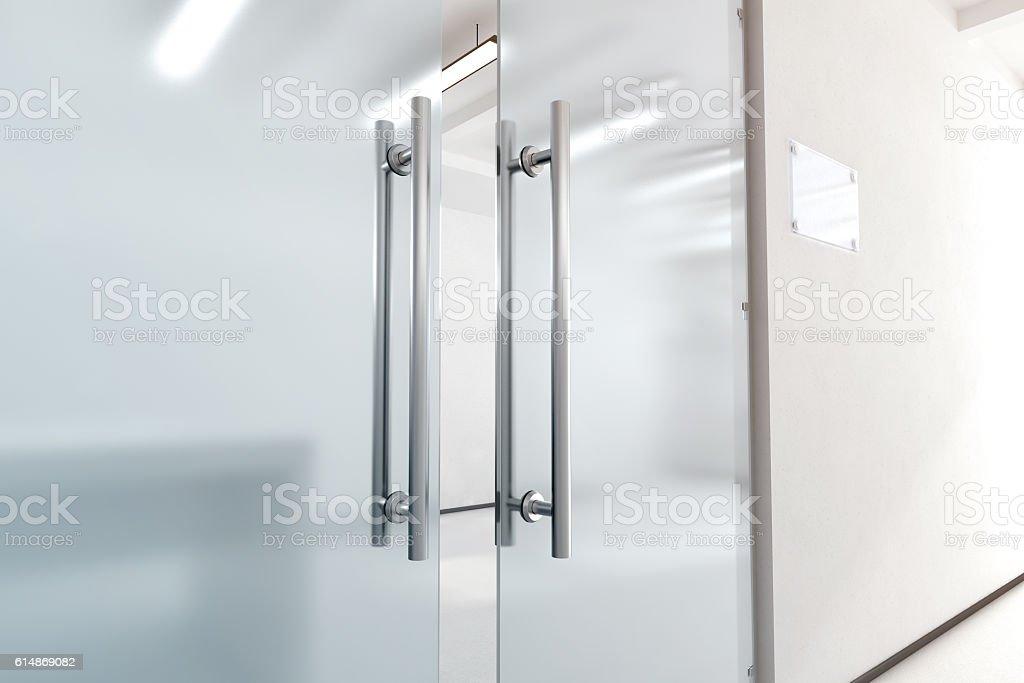 Blank glass door with metal handles mock up, stock photo