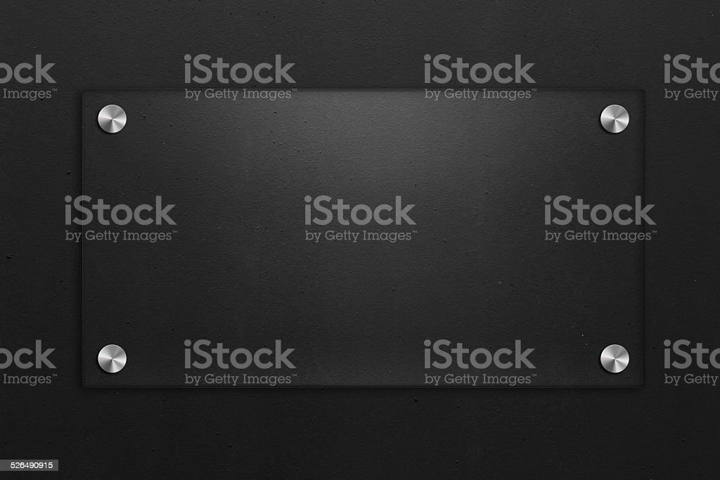 Blank glass plate with black textured background stock photo