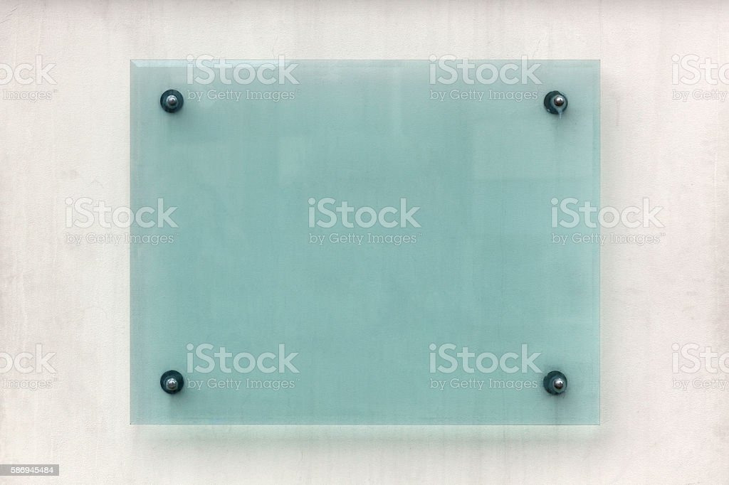 Blank glass sign on a wall stock photo
