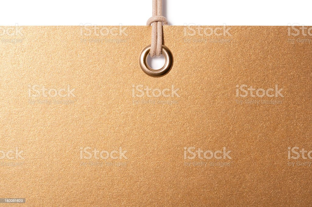 Blank Gold label hanging from cord royalty-free stock photo