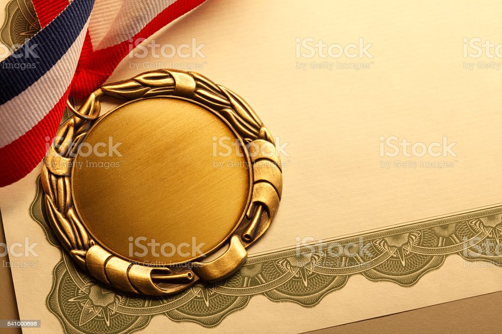 Blank Gold Medal On An Award Certificate stock photo