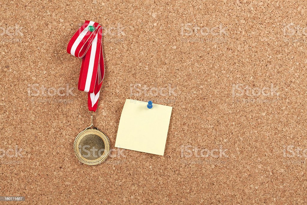 Blank Gold Medal with Post-it on Corkboard royalty-free stock photo