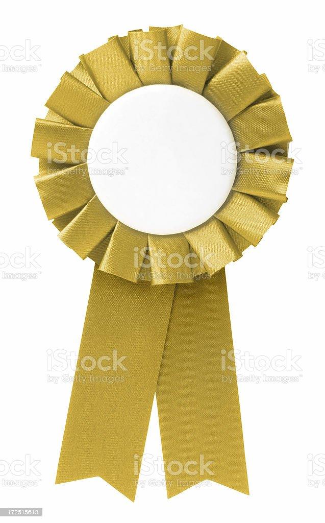 Blank gold ribbon rosette on white background stock photo