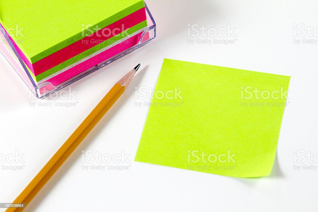 Blank green Post it Note with pencil on a white. stock photo