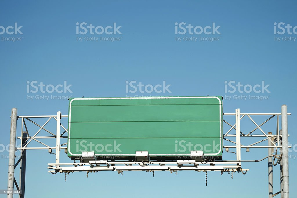 Blank Green Transportation Highway Information Sign Over Clear Sky royalty-free stock photo