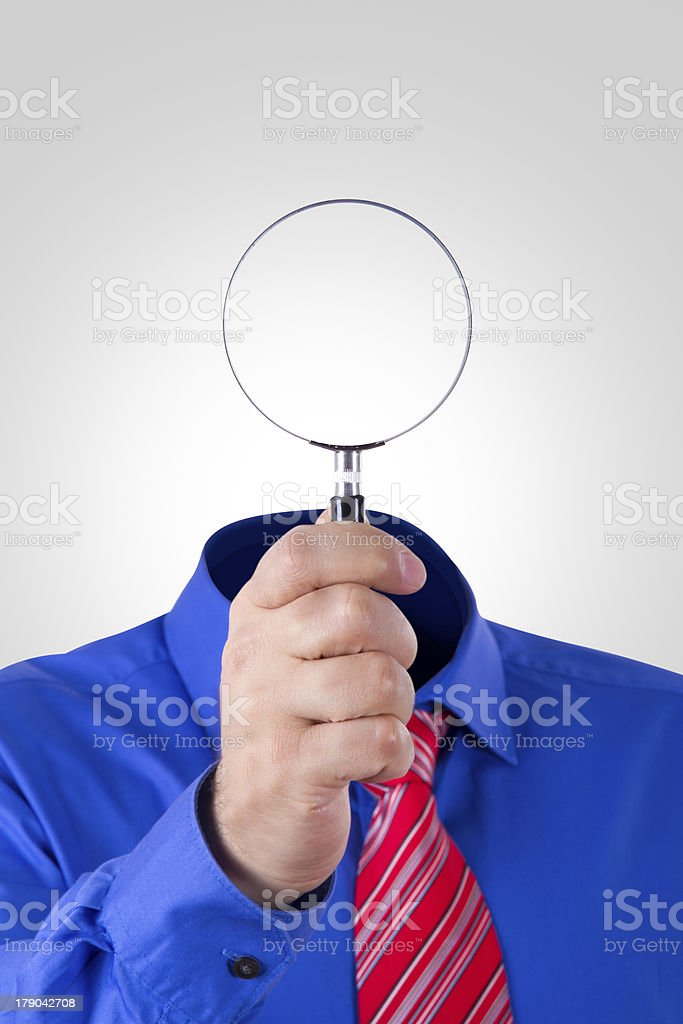 Blank Headed Man Holding Magnifying Glass royalty-free stock photo