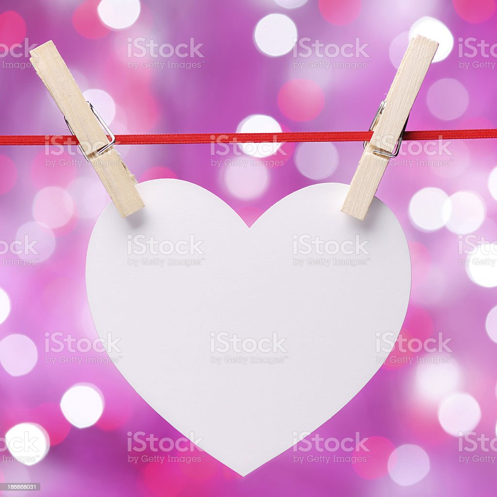 Blank heart shaped note on clothesline royalty-free stock photo
