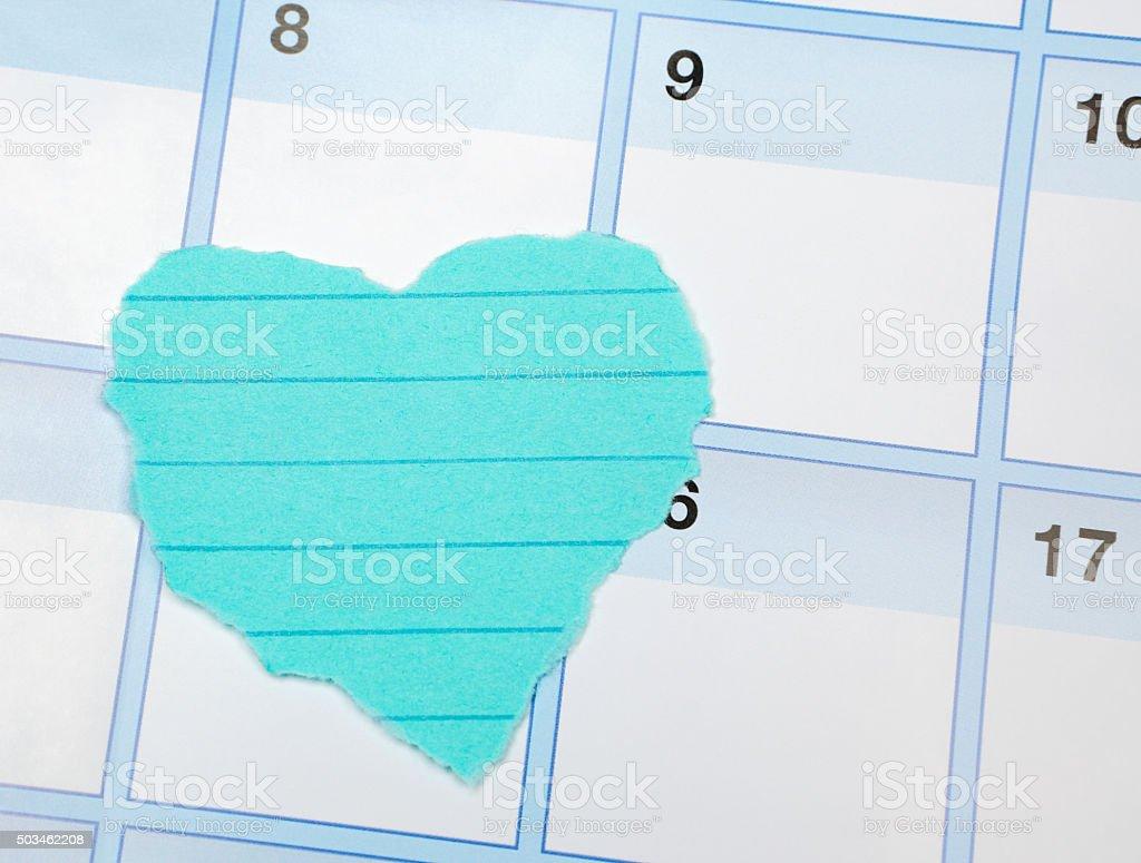 Blank Heart Shaped Paper on a Calendar stock photo
