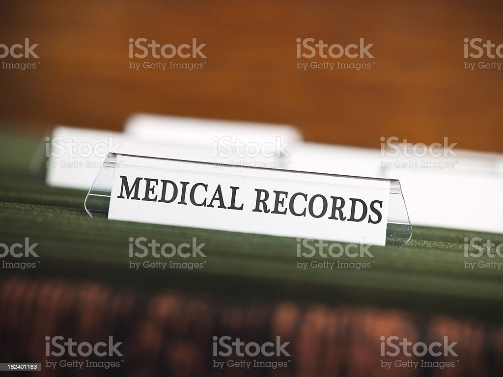 Blank hospital file in a filing cabinet stock photo