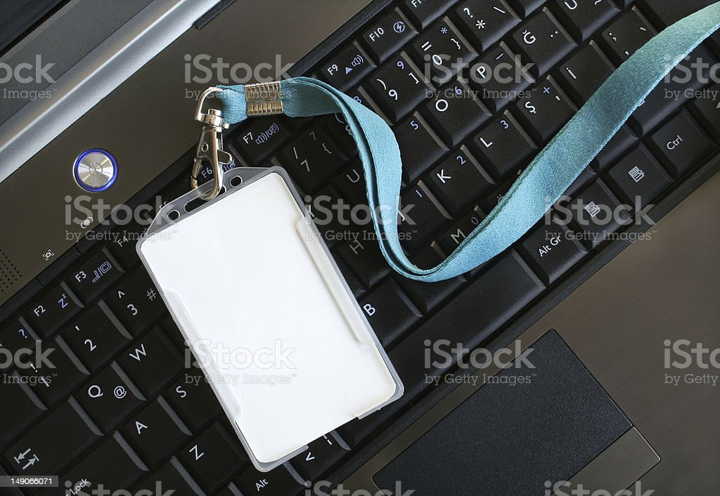 Blank ID card / badge on laptop /notebook stock photo