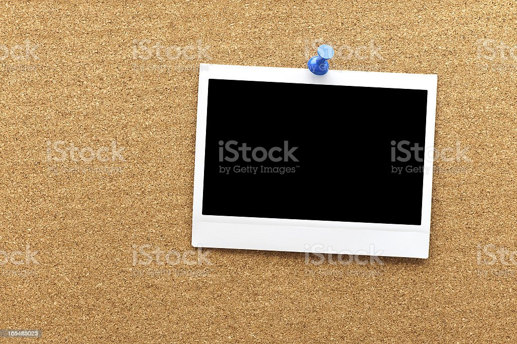 Blank instant photo frame at the cork board royalty-free stock photo