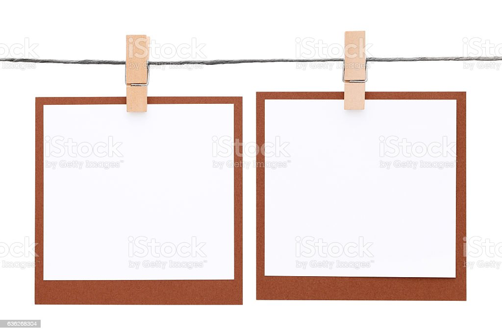 Blank instant photo hung on rope stock photo