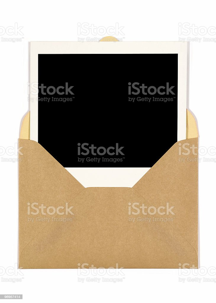 Blank instant photo print inside a brown envelope stock photo