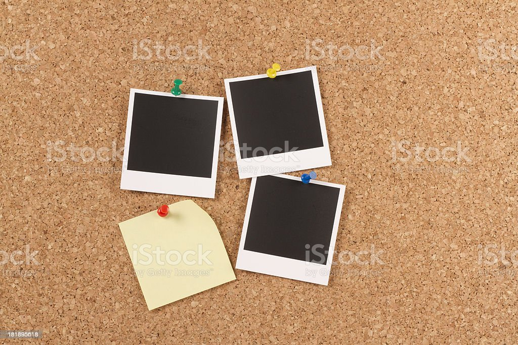Blank Instant Photo Prints with Post-it on Corkboard royalty-free stock photo