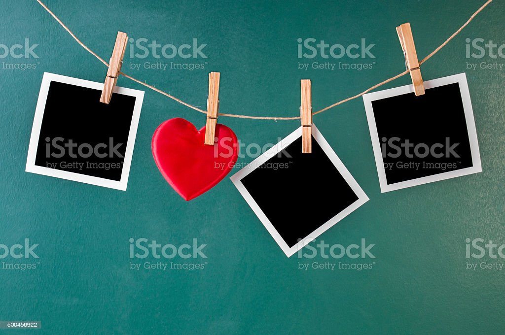 Blank instant photos and valentines toy heart stock photo