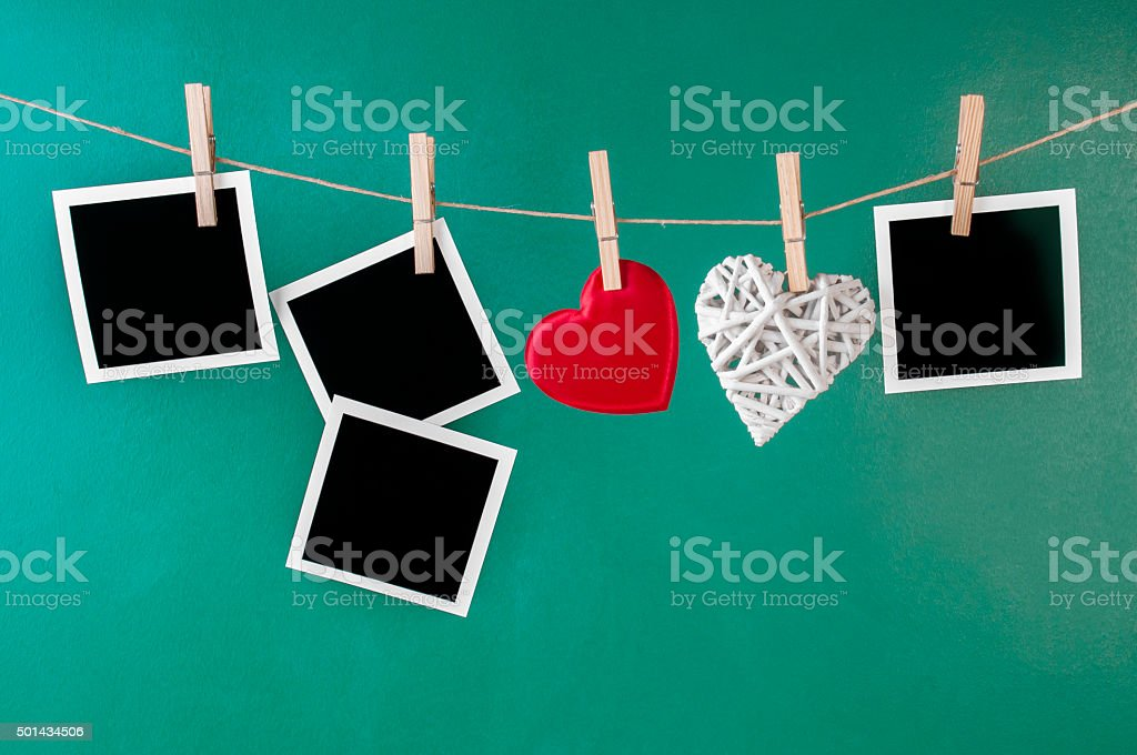 Blank instant photos and valentines toy hearts stock photo