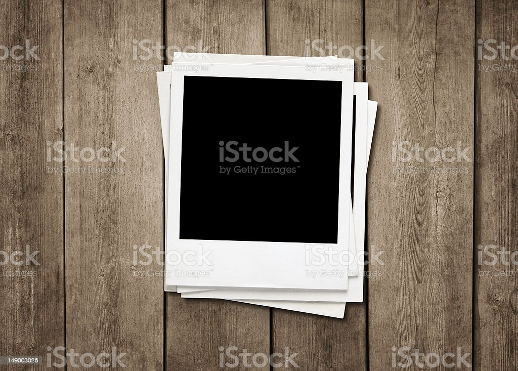 Blank instant photos at wooden background stock photo