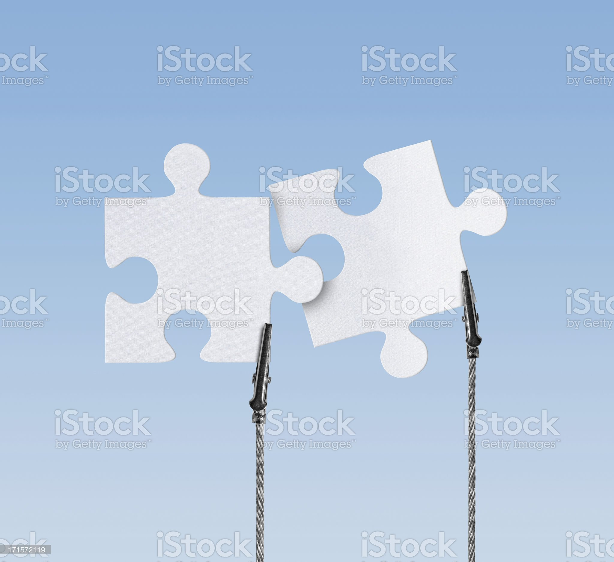 Blank, Jigsaw Puzzle in Wire Clam (Clipping Path) royalty-free stock photo