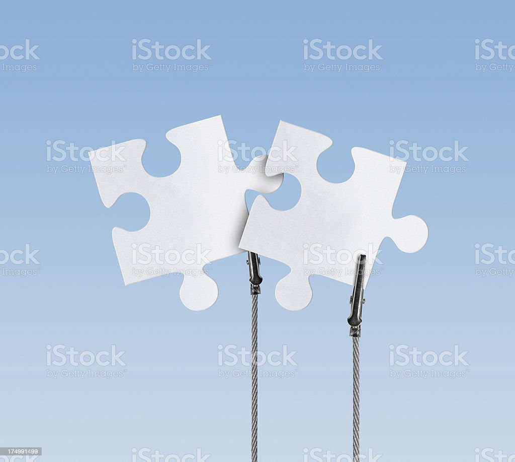 Blank, Jigsaw Puzzle in Wire Clam (Clipping Path) stock photo