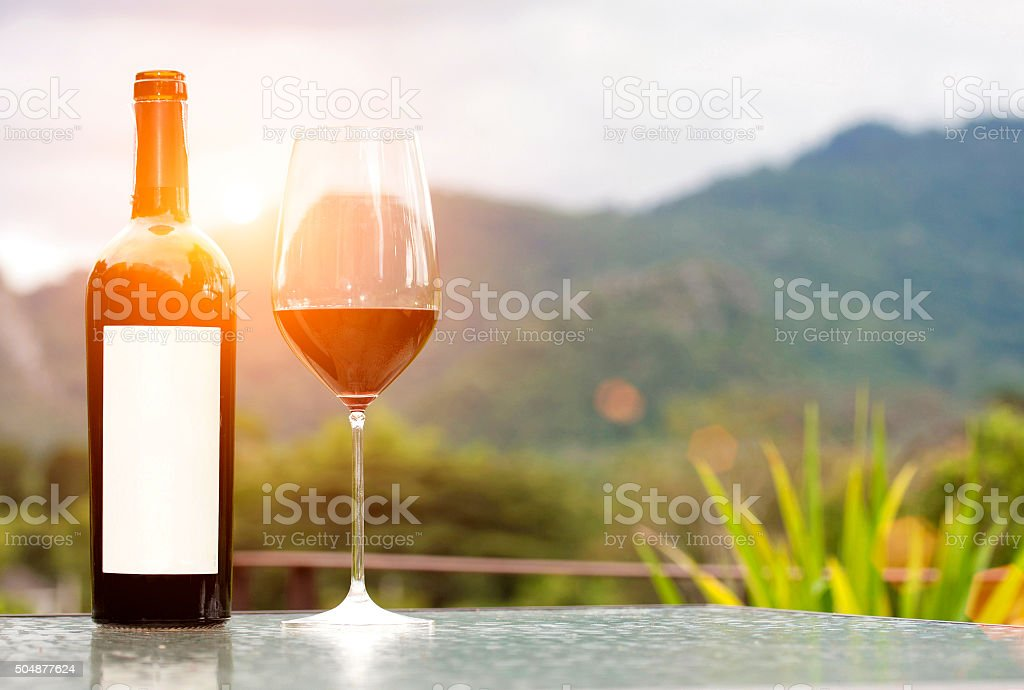 Blank label bottle of red wine with a glass stock photo