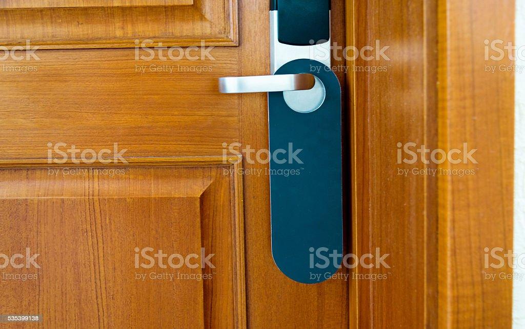 Blank label hanging on the door handle stock photo