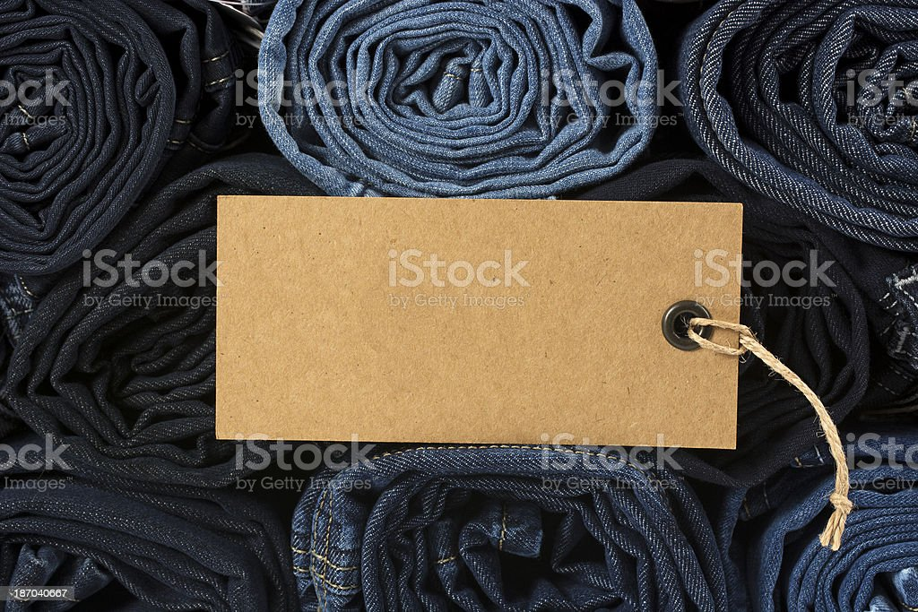 Blank label on roll denim jeans stock photo